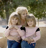 Grandma Hugs. Youthful Grandmother With Her Twin Grandchildren Stock Photos