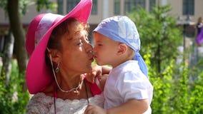 Grandma kissing grandson stock footage