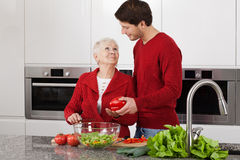 Grandma at kitchen Stock Photos