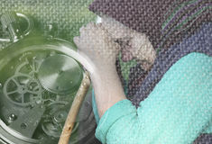 Grandma leaned her head on his hands. Leaning on a stick. Stress and uncertainty that brings old age. Reflection on the transience of life.Broken stopwatch Royalty Free Stock Photo