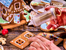Grandma makes a gingerbread house. Royalty Free Stock Photos