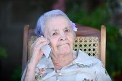 Grandma making phone call Royalty Free Stock Image