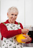 Grandma making a pie Royalty Free Stock Photos