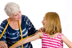 Grandma measuring child for clothes Royalty Free Stock Photo