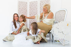 Grandma, mother and daughters. Portrait of happy grandma, mother and daughter in studio Royalty Free Stock Photo