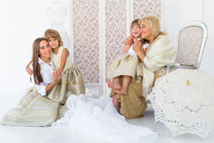 Grandma, mother and daughters. Portrait of happy grandma, mother and daughter in studio Royalty Free Stock Photos