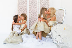Grandma, mother and daughters. Portrait of happy grandma, mother and daughter in studio Royalty Free Stock Images
