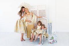 Grandma, mother and daughters. Portrait of happy grandma, mother and daughter in studio Stock Image