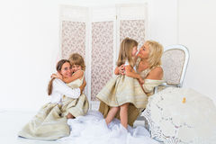 Grandma, mother and daughters. Portrait of happy grandma, mother and daughter in studio Stock Photography