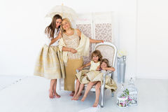 Grandma, mother and daughters. Portrait of happy grandma, mother and daughter in studio Stock Images