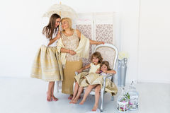 Grandma, mother and daughters. Portrait of happy grandma, mother and daughter in studio Stock Photo