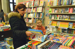 Grandma and nephew choosing a book. In a bookshop Stock Images