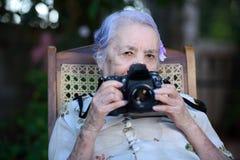 Grandma photographer Stock Photo
