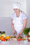 Grandma preparing dinner Stock Photos