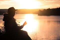 Grandma read a book in nature. Grandma read a book in nature silhouette stock photo