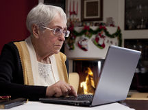 Grandma reads e-mail Royalty Free Stock Photos