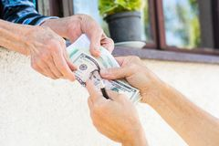 Grandma receiving retirement money at home. Grandma receiving retirement money on the window at home Royalty Free Stock Photography