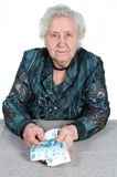 Grandma with Russian money. Stock Photos