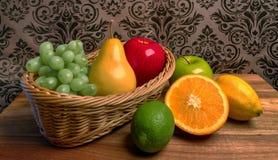 Grandma`s Basket of Assorted Fresh Fruits Royalty Free Stock Photography