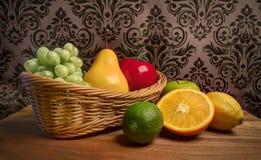 Grandma`s Basket of Assorted Fresh Fruits Stock Photo
