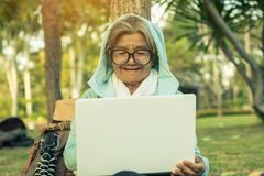 Grandma buying power on the online market. Stock Images