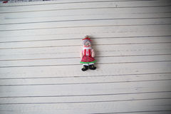 Grandma's doll rests on a wooden background. Christmas toy on a wooden background Stock Photos