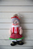 Grandma's doll rests on a wooden background. Christmas toy on a wooden background Royalty Free Stock Image