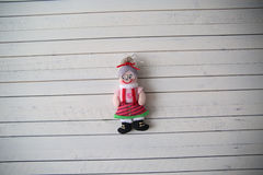 Grandma's doll rests on a wooden background. Christmas toy on a wooden background Stock Images