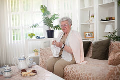 Grandma`s favorite time to crochet stock images