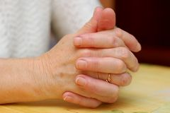 Grandma's folded hands. A pair of old and wrinkled hands Stock Images