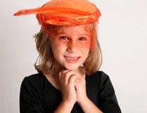 Grandma's hat. Young girl wearing fancy women's hat Royalty Free Stock Photos