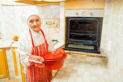 Grandma's kitchen. Grandmother preparing food in the kitchen stock images