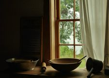 Grandma's Kitchen. Looking through the kitchen window with an old wooden bowl and washboard at the antique wooden table, Fayette State Historic Park Fayette royalty free stock photo
