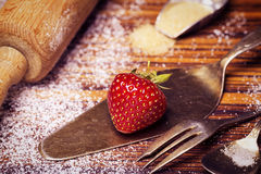 Grandma's kitchen with strawberries. Sugar, rolling pin, and silverware royalty free stock photos