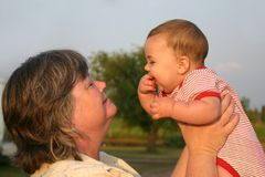 Grandma's Little Baby. A grandma and baby smiling at each other Stock Photo