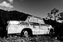Grandma's old car. Old car and the mountains in the caribbean Stock Images
