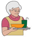 Grandma Serving a Meal. A kindly grandmother is serving a hot meal on a tray Royalty Free Stock Image