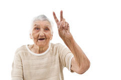 Grandma shows peace. Grandma showing peace sign on an isolated background royalty free stock images