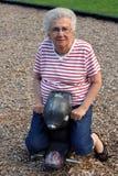 Grandma Skunkrider 2. Senior citizen woman on a playground ride royalty free stock photo