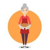 Grandma with sweet pie in her hands. Stock Photo