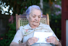 Grandma with tablet Royalty Free Stock Photo