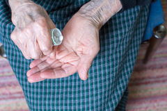 Grandma taking pills Royalty Free Stock Photos