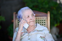 Grandma talking on phone Royalty Free Stock Image