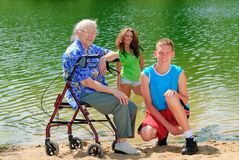 Grandma and teens by lake. Teenagers with their grandma outside Royalty Free Stock Images