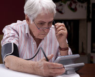 Grandma tonometer measuring your blood pressure Stock Photo
