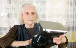 Grandma trying to use VR goggles. At home royalty free stock images