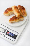 Grandmas bun rolls on the digital kitchen scale Royalty Free Stock Images