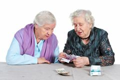 Grandmas are counting money. Two Grandma are counting Russian money. Isolated. Senior people series Royalty Free Stock Image