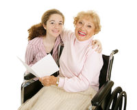 Grandmas Greeting Card. Teen girl gives greeting card to her grandmother for mothers day or other holiday Stock Images