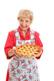Grandmas Homemade Cherry Pie. Sweet grandmother holding a delicious homemade cherry pie.  Retro look, isolated on white Stock Image